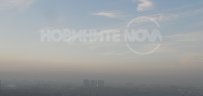 Мъглив залез в София
