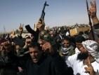 Открити са тела на поне 21 войници на Кадафи близо до Аждабия