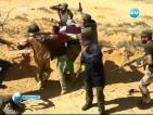 Погребаха Кадафи на тайно място в либийската пустиня